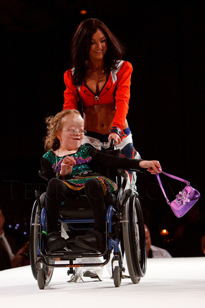 "(Denver, Colorado, Oct. 15, 2011)<br /> Alexandra Shankle escorted by a Denver Broncos cheerleader.  The ""Be Beautiful Be Yourself Fashion Show 2011,"" benefiting the Global Down Syndrome Foundation, at the Hyatt Regency Denver at the Colorado Convention Center in Denver, Colorado, on Saturday, Oct. 15, 2011.<br /> STEVE PETERSON"