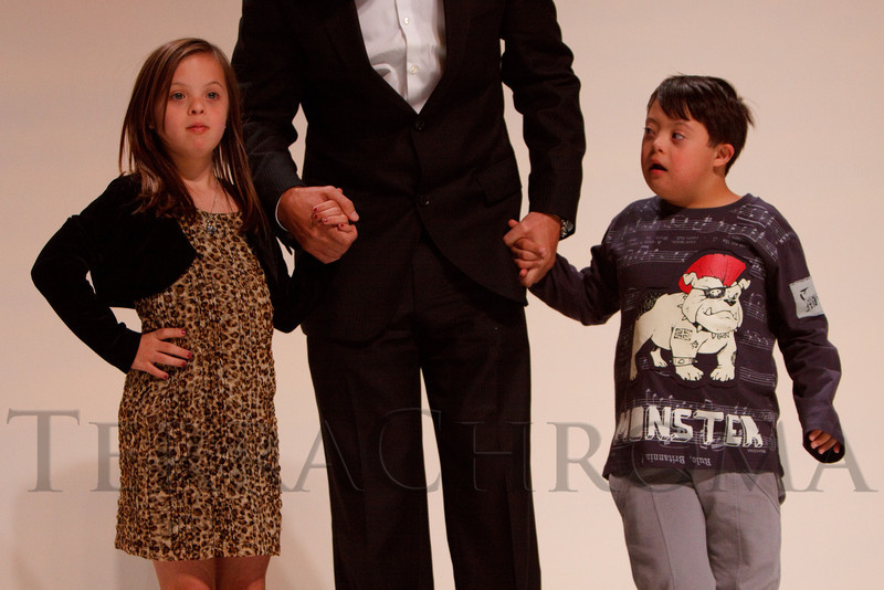 "(Denver, Colorado, Oct. 15, 2011)<br /> Emma Bolger and Pabilito Montoya Baca are escorted by Conor Casey (center, with the Colorado Rapids).  The ""Be Beautiful Be Yourself Fashion Show 2011,"" benefiting the Global Down Syndrome Foundation, at the Hyatt Regency Denver at the Colorado Convention Center in Denver, Colorado, on Saturday, Oct. 15, 2011.<br /> STEVE PETERSON"