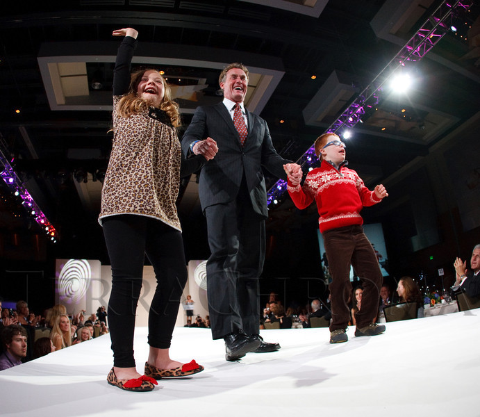 """(Denver, Colorado, Oct. 15, 2011)<br /> John McGinley with models Jaide Tygart (left) and Miles Ross.  The """"Be Beautiful Be Yourself Fashion Show 2011,"""" benefiting the Global Down Syndrome Foundation, at the Hyatt Regency Denver at the Colorado Convention Center in Denver, Colorado, on Saturday, Oct. 15, 2011.<br /> STEVE PETERSON"""