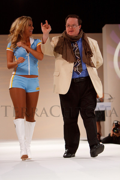 "(Denver, Colorado, Oct. 15, 2011)<br /> A Denver Nuggets dancer escorts Steve Ballard.  The ""Be Beautiful Be Yourself Fashion Show 2011,"" benefiting the Global Down Syndrome Foundation, at the Hyatt Regency Denver at the Colorado Convention Center in Denver, Colorado, on Saturday, Oct. 15, 2011.<br /> STEVE PETERSON"