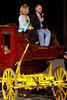 (Denver, Colorado, Oct. 22, 2011)<br /> Dianne and Tom Honig atop a Wells Fargo stagecoach.  Western Fantasy, benefiting Volunteers of America, Colorado Branch, at the National Western Events Center in Denver, Colorado, on Saturday, Oct. 22, 2011.<br /> STEVE PETERSON