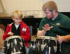 Paxon Dewett, left, plays a bongo drum during The Arts Fair held at the Wright State University  Creative Arts Center on Oct. 15, 2011<br /> ©  2011 Photograph by Skip Peterson<br /> permission granted by father Tom Dewett, WSU business prof, ext. 2216