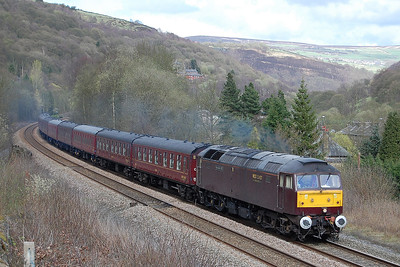 47786 'Roy Castle OBE' approaches Eastwood (between Hebden Bridge and Todmorden) with 5Z34 1305 Barnetby - Carnforth ECS move off a steam-hauled charter the previous day (03/04/2011)