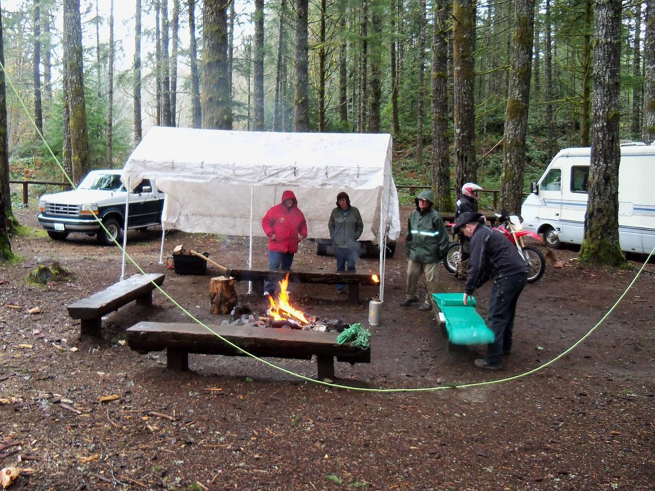 2011 Polar Bear.. Gary's pole shelter is up & Kurt gets out the big 60' x 60' tarp..