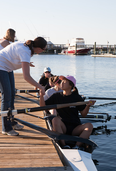 Coach Courtney shaking Novice Girls' hands
