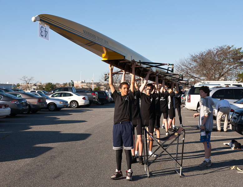 Novice Boys carrying boat