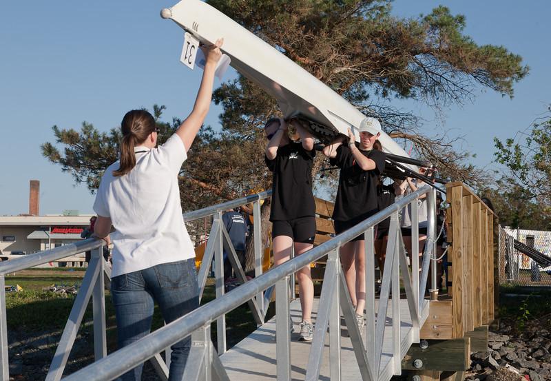 Novice Girls walking boat down the ramp