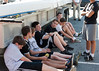 Boys resting in the shade of the trailer: Jonah, Nick, Simon, Ted, Daniel, Jonah, William, and Susmit (standing)