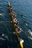 Boys Novice Eight rowing under bridge