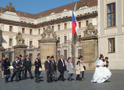 Finally, we made it up to Prague Castle, where I found the same wedding couple who had been posing on Charles Bridge at dawn, posing for more photos, this time with their extended families in tow.