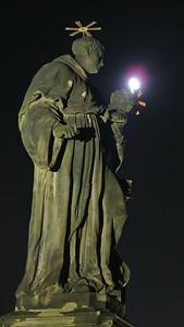 Charles Bridge statue with moon