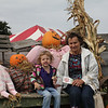 Addison and Nana with pumpkin family and eating donuts
