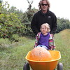 Rob pushing a wheel barrel and a pumpkin and a punkin...