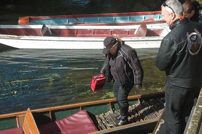 Jan carries the liferaft aboard