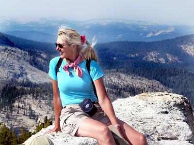 Siting on a peak gazing at others is like looking good friends in the eyes.   Karen on top of Tenaya Peak.