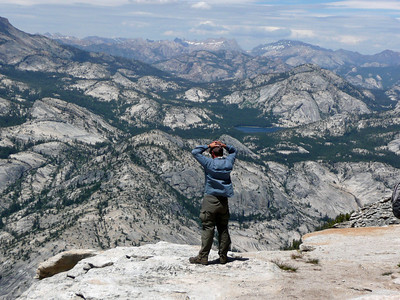 Yosemite teaches awe and gratefulness to be a part of it all. Guide Mike speechless on top of Clouds Rest looking to the northern boundary of the Park.