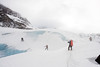 Greg leads a massive chain of rescuers out onto the blue ice of the glacier.