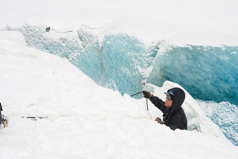 Almost out of the crevasse, Greg finally gains eye contact with his team.