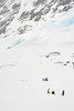 Teams pass the litter downhill alongside Eklutna Glacier.
