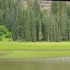 A kayaker fishing in the marsh off Hyas Lake.