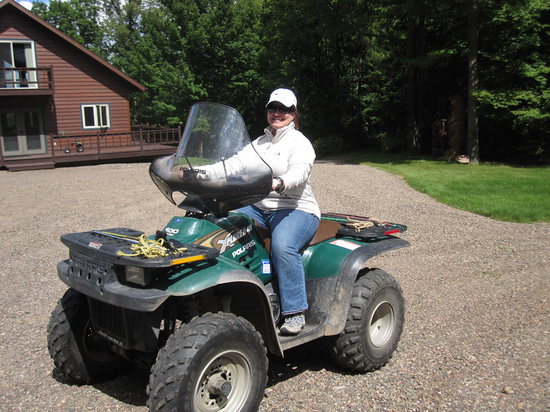 THE FIRST PHOTO OF THE WEEKEND...OF COURSE ...IS OF JENNY ON HER 4-WHEELER