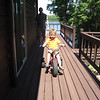 HOW MANY MILES DID ALEX PUT ON HIS TRICYCLE ON THE DECK...TOO MANY TO COUNT