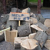 JP'S WOODPILE WAITS FOR HIM TO ATTACK IT...LOOKS LIKE HE'S ADVERTISING FOR HELP?