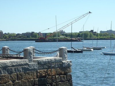 Barge being pushed past the Boston Sailing Center.