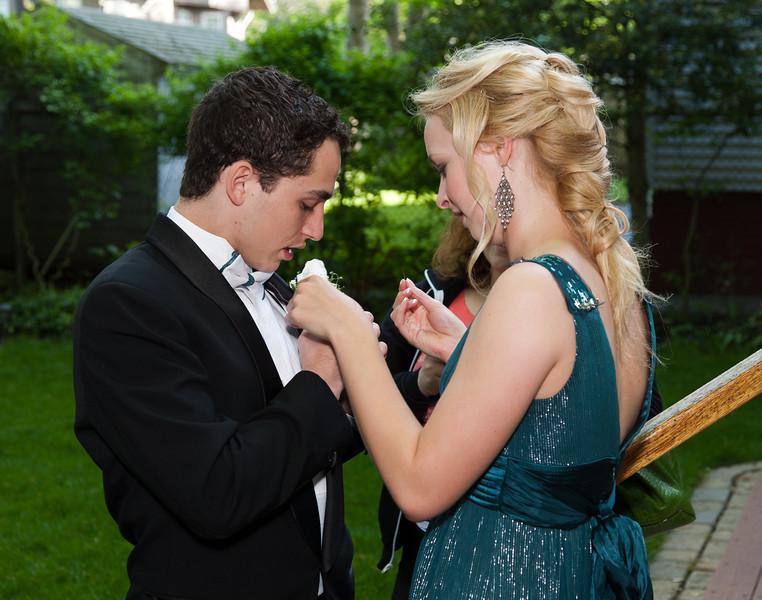 Sophia pinning corsage on Louie