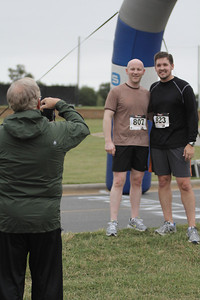 Two runners have the photograph taken after finishing the Centennial Sprint 5K.