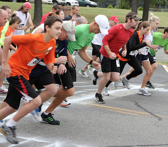 Runners take off at the sound of a bullhorn to begin the Centennial Sprint 5K.