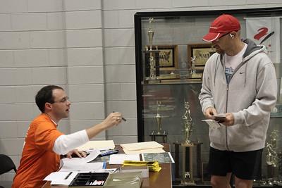 A runner registers for the Centennial Sprint 5K.