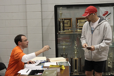 A runner registers for the Centennial Sprint 5K.