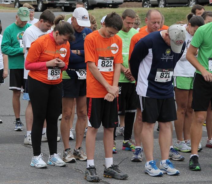 The runners were lead in prayer before the Centennial Sprint 5K began.