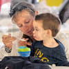 Yummy: Two-year-old Wesley Pratt gets a spoonful of potato salad from his mother Elise during their Thursday afternoon visit to the annual Oktoberfest.