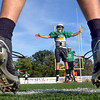 Flying High: North Central quarterback Zach Lyday (center) is flying high during a drill as the team prepares to play on the Memorial Stadium surface. The team comes to town with a 4-0 record.