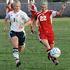 Push it: South's #22, Courtney Hubbard pushes the ball as she's being chased by North's #1 Joy Jakaitis during game action Thursday night.