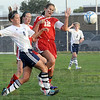 Congested: North's #4, Molly McKee fights with South's #15, Cassidy Wood and #12, Katherine Senseman during game action Thursday.
