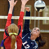 Tribune-Star/Jim Avelis<br /> Spiked: Terre Haute North's Mikinzi Kiefer gets a kill past the defense of Edgewood's Ashley Hacker.