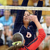 Tribune-Star/Jim Avelis<br /> Do not enter: Mande Eberle blocks a spike by Edgewood's Rachel Delay in their match at Terre Haute North.