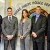 New officers: Terre Haute Police Chief John Plasse (L) and Mayor Duke Bennett (R) pose for a photograph with newly sworn THPD officers Daniel LaFave, Marcia Bahr and Aaron Childress at police headquarters Thursday afternoon.