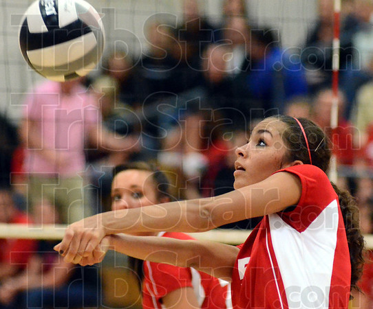 Tribune-Star/Jim Avelis<br /> Defense: Terre Haute South's Ashley Bazier sets up a teammate in the Braves match with crosstown rivals Terre Haute North.