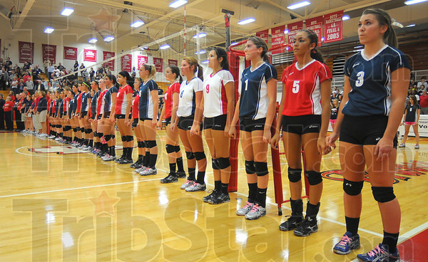 Tribune-Star/Jim Avelis<br /> United for now: Terre Haute North and Terre Haute South players alternate down the line for the National Anthem prior to their Volleyball For The Small game Thursday evening.