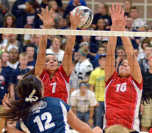 Tribune-Star/Jim Avelis<br /> Too much: Kinzi Kiefer watches her kill shoot past the defense of Terre Haute South's Abbey Richards and Kaylee Compton.