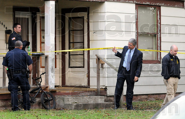Shooting scene: Vigo County Chief Deputy prosecutor Rob Roberts leaves the scene of Thursday's homicide at 1820 South 8th Street after several hours of investigation.