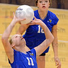 Tribune-Star/Jim Avelis<br /> Setting up: Natalie Scamihorn passes the ball to another Honey Creek player in the Bee's championship match with Woodrow Wilson. Watching is team mate Emma Burke.