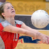 Tribune-Star/Jim Avelis<br /> Bump: Hannah Veldhuizen passes the ball to a teammate in Woodrow Wilson's match with Honey Creek for the county championship in middle school volleyball.
