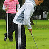 Tribune-Star/Jim Avelis<br /> State bound: Terre Haute South senior Morgan Patterson will represent her school this weekend in the state golf championships. Watching her putting form is her coach and former South standout Cara Stuckey
