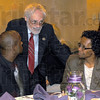 Tribune-Star/Jim Avelis<br /> Honored: Chuck Norman (center) a commissioner with the Terre Haute Human Rights coalition, chats with Marlin Hill and his mother Marlena Johnson-Hill. Marlin Hill was one of the award recipients Thursday night.