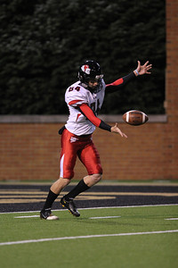Senior, Graham Purvis, 84, punts the ball for Gardner-Webb.